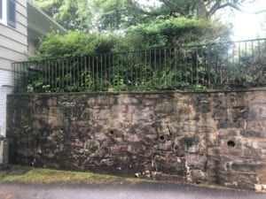 stone wall pressure washed, black marks, oil, dirt, moss, mold, mildew, fungi, algae, soot, stains