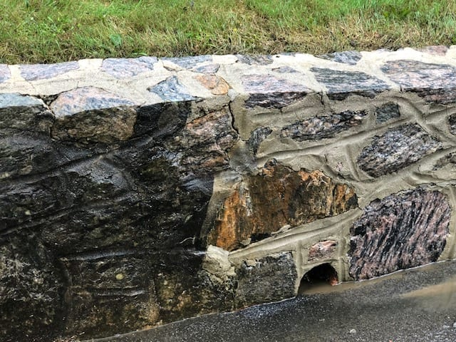 Pound Ridge, Scarsdale, Chappaqua, Bedford Hills, Before and After of stone wall pressure washed, black marks, oil, dirt, moss, mold, mildew, fungi, algae, soot, stains